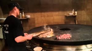 grillk che bd s mongolian grill knife tossing chef