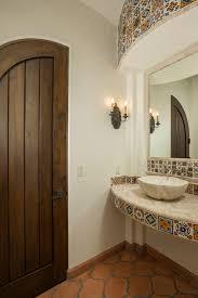 Mexican Wall Sconce Mexican Bathroom Bathroom Mediterranean With Dark Wood Door