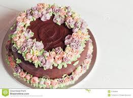 homemade chocolate cake with colorful cream flowers stock photo