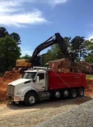 site development grading excavation dumptruck hauling materials