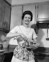 1960s woman kitchen housewife stir posters u0026 prints by corbis