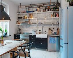 well organized small kitchen black floating shelves white kitchen