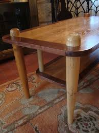 custom made baseball bat coffee table by uncommon woodworks