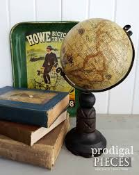 old world globe on hand carved wooden stand prodigal pieces