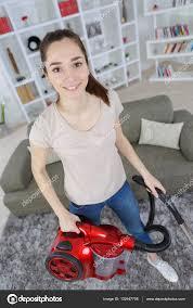 vacuuming the carpet u2014 stock photo photography33 132947708