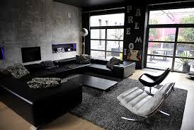 salon avec canapé noir loft location pour photos tournages événements en belgique