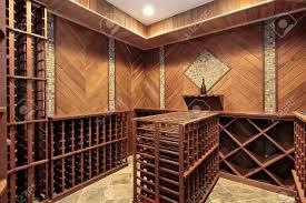 wine cellar in luxury home with multiple racks stock photo