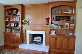 interior classic white wooden built in bookcases fireplace