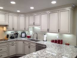 Over Cabinet Lighting For Kitchens Kitchen Above Cabinet Lights White Brick Wall Stainless Steel Gas