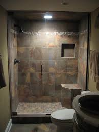 brown ceramic flooring and wall tile in modern small bathroom