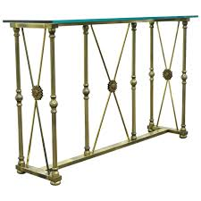 glass and metal console table mastercraft x form brass and glass console table in the