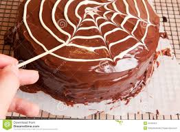 making spiders web on the chocolate cake stock photo image 46180420