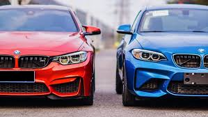 modified bmw m4 bmw m2 next to the m4 for a photoshoot