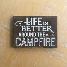 camping life is better around the campfire fire pit hand