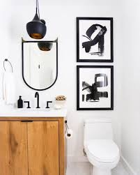 small powder room with black faucet and wooden vanity ways to