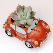 peach car car planter with a plant by dingading terrariums