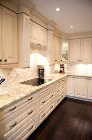 backsplash for cream cabinets color kitchen tiles traditional cream cabinet with clay light brick