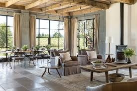 open floor plan farmhouse rustic ceiling lights living room farmhouse with wood stove metal
