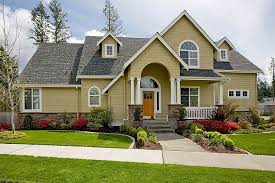 yellow exterior paint pale yellow exterior home color with grey roof and lush green