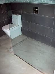 grey concrete floor and black tiles wall curbless shower with