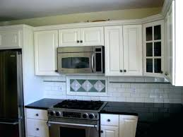 how to professionally paint kitchen cabinets eye catching cost to paint kitchen cabinets professionally uk