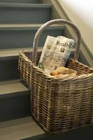 use this cute step basket to corral items that belong upstairs