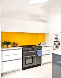 yellow and white kitchen ideas white modern kitchen with yellow splashback yellow interiors