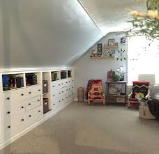 slanted ceiling closet design ideas pictures remodel and built in dressers in attic space boys room with slanted ceilings