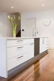 gorgeous white kitchen with natural floorboards that look