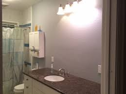 off center sink bathroom vanity need help center a bathroom light over sink or cabinet