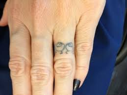 ring tattoos anybody got one