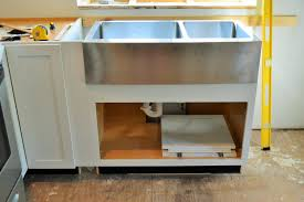 how to install farm sink in cabinet diwyatt adjusting the apron sink base before installation