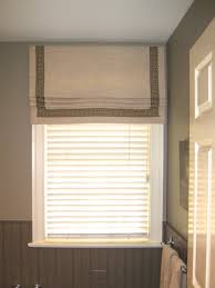 tape trim adds an elegant border to this roman shade tape trims