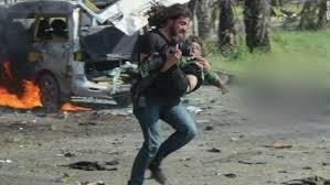 haba k che syrian photographer helps boy cnn