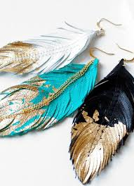 one side feather earring best 25 feather earrings ideas on feather jewelry