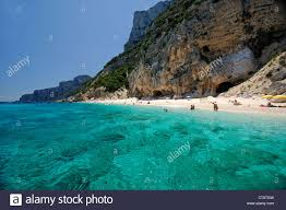Beach Transparent by Clear And Transparent Sea Waters With Tourists At Cala Dei