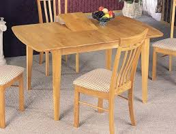 round table with chairs that fit underneath dining table chairs fit underneath this natural finish table is