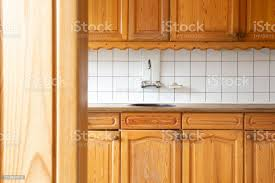 vintage kitchen wall cabinet white view of a classic wooden and kitchen with white tiled wall retro vintage design complete furniture closeup stock photo image now