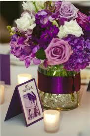 low centerpiece of purple hydrangea lavender roses stock