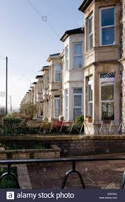 bay windows terrace houses stock photos bay windows terrace a row of bay windows in perspective in a street of victorian terraced houses in