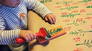 make your own wrapping paper with create christmas wrapping paper with your toddler