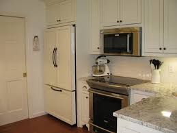 smart white painted wood kitchen cabinet with built in fridge