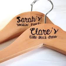 pair of personalised wooden coat hangers by bespoke oak co