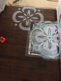 stenciled hardwood floor stencil made with sihouette cameo