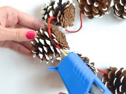 diy holiday pinecone garland hgtv