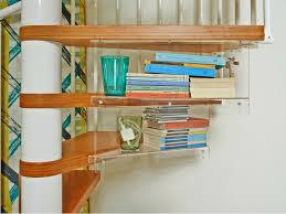 ingenious hidden under stairs storage using floating glass book