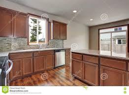Kitchen With Brown Cabinets Modern Kitchen Room Interior In An Empty House Furnished With