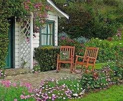 houses dreamlike place flowers swing chears cottage roses terrace