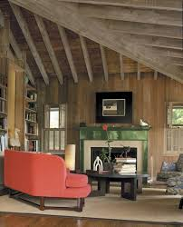 interior wood beams living room rustic with stacked books themed