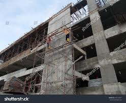 working height scaffolding without safety harness stock photo